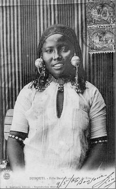 "Africa | ""Dankali girl in festival dress"".  Djibouti.  Dated 1906 