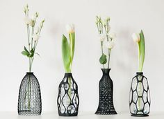 With the help of 3D printing technology, designer Libero Rutilo of DesignLiberohas reimagined recycling as an art form. He's designed mesh-like sculptural shells that are intended to be placed on top of half-liter plastic bottles, making modern vases from what might have been tossed in the trash.  Rutilo's innovative line of vases include four designs: the spider vase,sinuous vase,lace vase,and knitted vase.