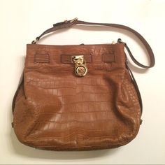 Holiday Sale! Crocodile Printed Michael Kors Bag Crocodile printed brown leather bag in like new condition. Has a magnetic clasp for shutting and lots of room inside with divider. 100% authentic gold hardware MICHAEL Michael Kors Bags Shoulder Bags