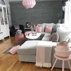 Too cute! We love pink and grey living rooms