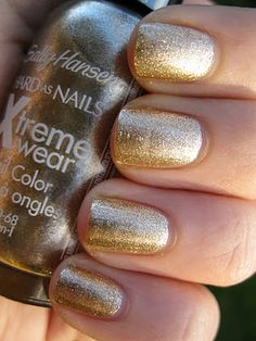 Following up the silver colour, I saw the gold and had to have it. So garishly delicious. Sally Hansen Golden-I.