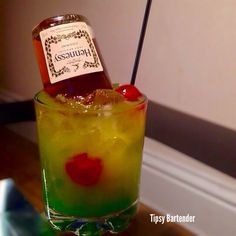 Tipsy Bartender You, Me & Hennessy- blue curacao, cherries, banana liqueur, apple vodka, mango juice, small bottle of Hennessey.