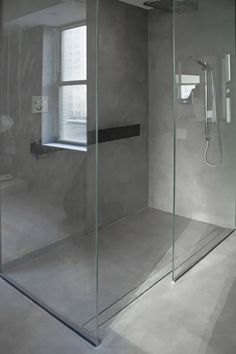 Ultra modern concrete shower in an entirely concrete bathroom. See how this unique design is both minimalist and textured with exposed raw concrete shower floor and walls. Bathroom Concrete Floor, Concrete Shower, Modern Bathroom Tile, Loft Bathroom, Bathroom Interior Design, Concrete Floors, Small Bathroom, Concrete Finishes, Wall Finishes