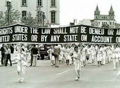 1937: Women march in Washington supporting the Equal Rights Amendment.