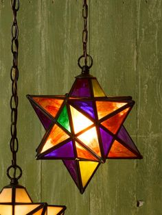This stained glass pendant lamp features rich colors tempered by panes of wavy translucent glass and a dark oil-rubbed-bronze frame, recalling decorative windows of old. | Meyda Tiffany from @wayfair
