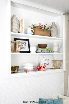 Love the styling on this built in bookcase. Love the bright and fun colors. Such great inspiration for my bookcase. Pinning for later!