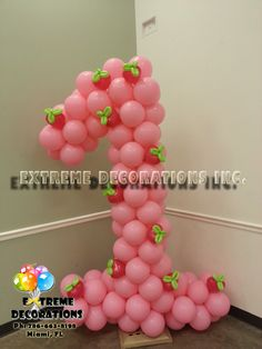 Strawberry Shortcake First Birthday. Age Number one balloon sculpture. Strawberry Shortcake party decoration ideas. Extreme Decorations Miami Ph: 786-663-8198