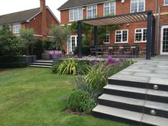 Kandla Grey Sandstone paving is heard-wearing and requires minimal maintenance, great for entertaining and dining areas in your garden! This beautiful patio and steps was completed by Cube 1994 Ltd.