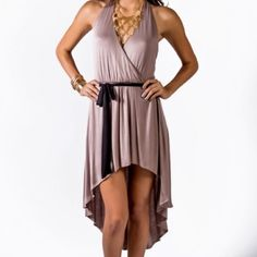 Beige Hi Low Dress This dress is sooo comfy! Seriously, ladies. You won't want to take it off. The back has some really fun gold colored embellishments. Brand new. Necklace not included. Dresses High Low