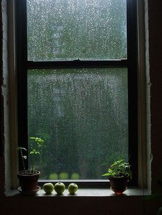 The sound of raindrops on the windows and roof top, and not having to go anywhere.  The warm, cozy, read a book kind of day!