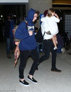 Chilled: Brooklyn looked laid back in a Thrasher hoodie and jeans, teamed with some Vans pumps