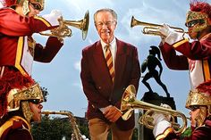 Dr. Arthur C.  Bartner, director of the USC Marching band since 1970,  is photographed with members of the unit next to the statue of Tommy Trojan on the USC campus on Aug. 12, 2011.