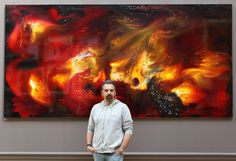 """Artist Keith Tyson stands in front of his painting entitled """"Deep Impact"""" on display in the Royal Academy of Arts' Summer Exhibition on June 2, 2011 in London, England. The Summer Exhibition is the world's largest open submission contemporary art show, now in its 243rd year, with over 12,000 entries received from 27 countries. The exhibition features over 1100 works of art including: painting, sculpture, photography, architecture and film, it officially opens to the public on June 7, 2011."""