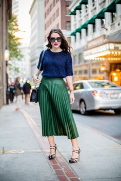 A blue fuzzy knit sweater and kelly green pleated midi skirt gives off a sophisticated and ladylike vibe.