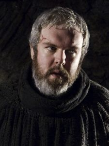 Hodor is a stableboy serving at Winterfell. He is large and slow of wits, but is gentle and loyal to the Stark family. He is only capable of saying one word, Hodor. Valar Dohaeris, Valar Morghulis, Kristian Nairn, Casa Stark, Ed Sheeran Lyrics, Sweet Games, Eddard Stark, Mal Humor, Tv Show Games