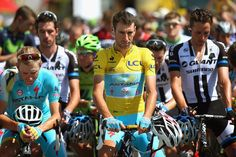 Race leader Vincenzo Nibali of Italy and the Astana Pro Team observes a minute's silence with the rest of the peloton in memory of the passengers who died in Malaysia Airlines flight MH17 crash at the start of stage thirteen of the 2014 Tour de France, a 197km stage between Saint-Etienne and Chamrousse, on July 18, 2014 iSaint-Etienne, France.