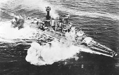 USS Maryland (BB-46) fires her main battery.