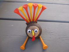 Thanksgiving Turkey Craft!  Made out of a golf ball!  This would be a great gift that Evie could make for Papaw.