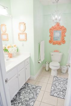 Mint & Coral Bathroom - Cute Decor I need those rugs!! My color are gray white raspberry purple and aqua