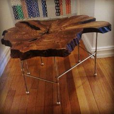 This table is made with a slab of teak, with a natural oil finish.  The legs are raw brass lamp wiring parts.