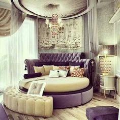 for the queen in all of us, round lush bed with surrounding curtain. i think i would need a couple different layers. sheer and darker and black out