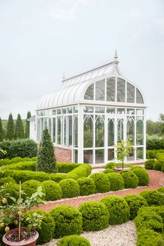 Secrets for a Formal Garden That's Also Fun Designed in the shape of a Gothic arch, the greenhouse has smaller arches tracing the glass windows.Designed in the shape of a Gothic arch, the greenhouse has smaller arches tracing the glass windows. Best Greenhouse, Backyard Greenhouse, Greenhouse Plans, Portable Greenhouse, Homemade Greenhouse, Pergola Garden, Pinterest Foto, What Is A Conservatory, Wooden Greenhouses