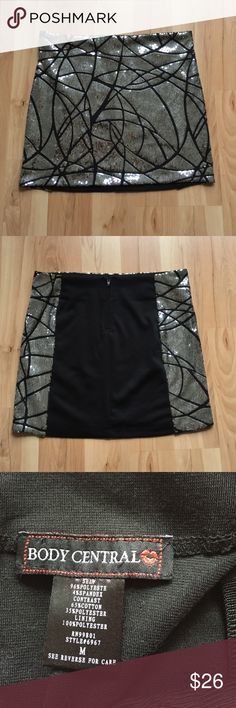 Sequin Mini Skirt Size M. Black mini skirt with sequin detail in front and wraps around hip. Zipper in back. Fully lined. Waist 14.5in. Hip 15.5in. Length 14in. Does have a little stretch to it. Skirts Mini