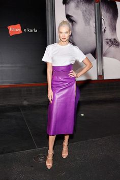 White tee outfit formula: White Tee + Purple Leather Skirt + Strappy Sandals. Seen here: Karlie Kloss