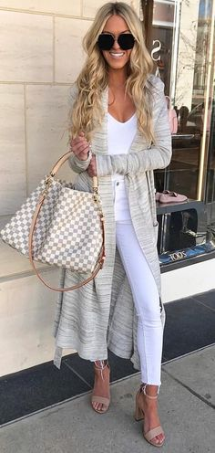 #spring #outfits woman in gray long cardigan and white shirt with white high-waist pants holding Damier Azur Louis Vuitton leather 2-way handbag standing while smiling during daytime. Pic by @macystucke