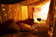 DIY for boys out there. Set up a fort like this with pillows and romantic lighting everywhere. Eat dinner and get buzzed in there, then have a sleepover. It will be like you two were little kids again and it will definitely win your girl over or just make your girlfriend extremely happy!