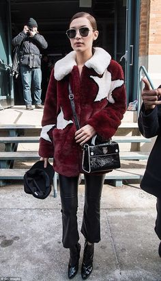 She's a star: After the show, model Bella changed into a fun faux fur coat from Guess...