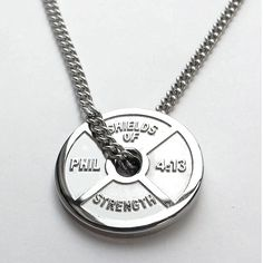 "Shields of Strength - Mens Weight Plate Stainless Steel Necklace-Phil 4:13-TM ""Reg"" No.4,611,243, $69.99 (http://www.shieldsofstrength.com/mens-weight-plate-stainless-steel-necklace-phil-4-13-tm-reg-no-4-611-243/)"