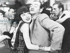 German film still from the 1920s, showing a couple dancing tango.