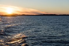 Ocean landscape in the arctic with sunset at an evening