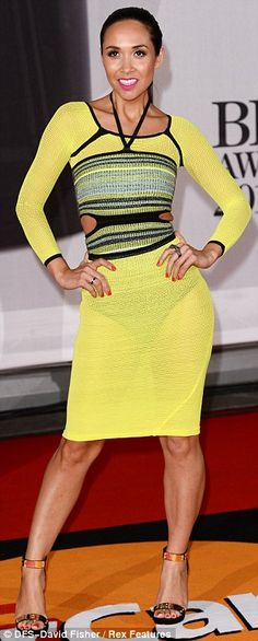 Can you see my underwear? Well, good! Myleene Klass showed off her skinny frame in a yellow Mark Fast creation