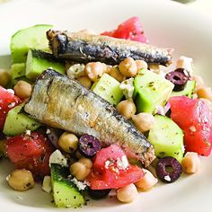 The fresh, tangy elements of a Greek salad--tomato, cucumber, feta, olives and lemony vinaigrette--pair well with rich-tasting sardines. Look for sardines with skin and bones (which are edible) as … Fish Recipes, Lunch Recipes, Seafood Recipes, Salad Recipes, Cooking Recipes, Greek Recipes, Cooking Time, Cucumber Recipes, Healthy Salads