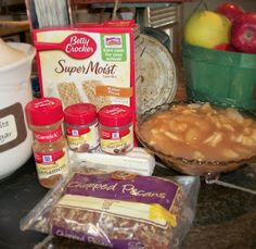 Apple Pecan Dump Cake Butter Pecan Cake Mix 5 cups Apple Pie Filling (I make my own but if you want to use canned, you will need 2-21oz. cans) 1 teaspoon cinnamon 1/2 teaspoon nutmeg 1/4 teaspoon allspice 1 1/2 cups chopped pecans 1 1/2 sticks (3/4 cup) margarine or butter -Preheat oven to 350 degrees. -Pour Apple Pie filling into the bottom of a 9×13 pan. -In a small bowl, mix cinnamon, nutmeg, and allspice. -Then sprinkle the spices on top of the apple pie filling. -Pour the