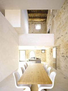 beautiful monochromatic room with amazing stone wall.