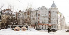 Blue eyes painted on wooden barrels by Nikita Nomerz in Nizhny Novgorod, Russia