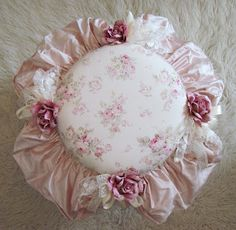 Shabby pillow with ruffles and roses?  Actually, it turns out this is a topper for a stool/chair, but wouldn't it be pretty as a pillow?