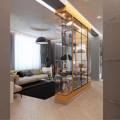 Вид с холла на гостиную с оригинальной витриной, как яркое цветовое пятно всего интерьера.  Изначально заказчик хотел сделать витрину красного цвета, но весь интерьер из-за этого расходился с общим стилем. Но увидев визуализацию своего будущего интерьера, был утверждён оранжевый цвет с первого раза. ☄️ #гостинная_iD #interideg #витрина #interiordesign #designstudio#houseidea #homedecor #interiordecor#homedesign #интерьер #интерьеры #дизайнинтерьера#дизайн_интерьера…