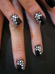 black fingernail polish with white spots
