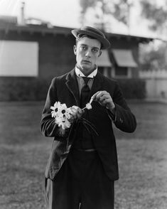 Buster Keaton.She loves me. She loves me not.