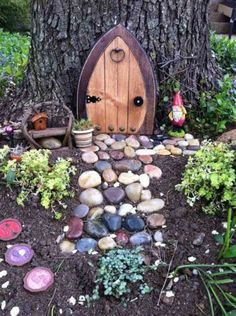 25 DIY Fairy Door Ideas from Popsicle or Wooden Craft Sticks & Rocks : You probably know by now that I'm a big fan of fairy gardens. I really love making them. Lately, I've been searching for inspiration for a big fairy garden Fairy Tree Houses, Fairy Village, Fairy Garden Houses, Gnome Garden, Garden Trees, Garden Paths, Herb Garden, Vegetable Garden, Diy Fairy Door