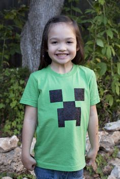 DIY Minecraft T-Shirt. Anyone with a child who is obsessed with the online game Minecraft, knows how expensive and hard it is to find official t-shirts. The youth sizes are never available! This is an excellent tutorial to make your own.easy too! Minecraft Crafts, Creeper Minecraft, Minecraft Skins, Minecraft T Shirt, Minecraft Stuff, Mine Minecraft, Minecraft Cake, Minecraft Pillow, Minecraft Backpack
