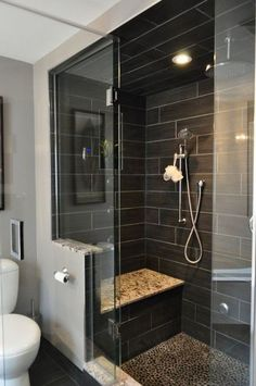 Slick! This is what our Realtor would call an FFS (Female Friendly Shower)! The dark gray tiles are gorgeous, and I LOVE the shower seat!