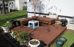 Recycled Deck from pallets and overseas shipping cartons.  Note the Koi pond that is painted in the middle.