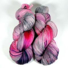 """This colorway is called """"Love Conquers All"""". It has streaks of red, pink, fuschia, purple and gray with gray speckles. Squish Wish: This yarn is extremely soft with excellent stitch definition. It's n"""