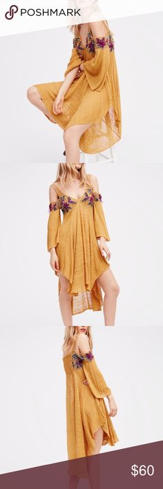 Found Paradise Tunic Pretty off shoulder sheer tunic featuring floral embroidery and crochet details. Flowy shape with side vents and femme flared sleeves. Styling Tip: This versatile top can also be worn as a mini dress. *55% Linen *45% Rayon *Trims: 100% Cotton and 100% Polyester *Hand Wash Cold *Import Measurements for size: Small *Bust: 32.0 = 81.3 *Waist: 33.0 = 83.8 *Length: 32.0 = 81.3 *Sleeve Length: 14.5 = 36.8 Free People Tops Tunics