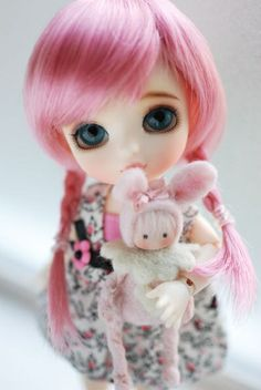 Cereal puff with her new doll...